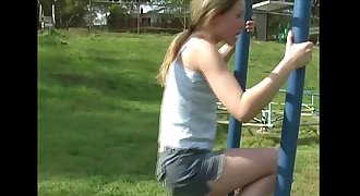 Young teenage plays in the park and flashes her body